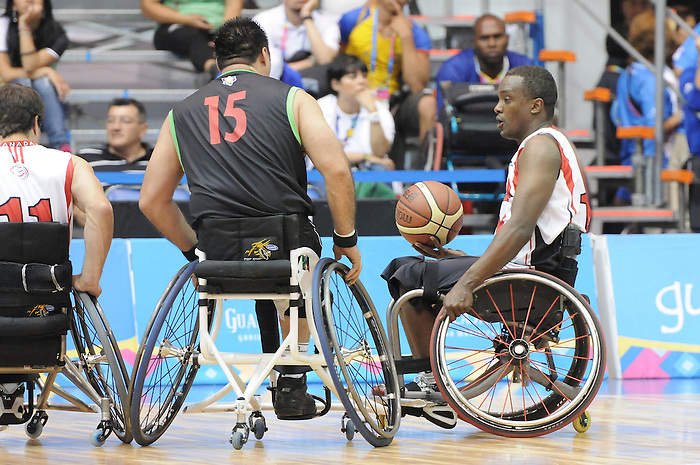 Abdi Fatah Dini, Guadalajara 2011 - Wheelchair Basketball // Basketball en fauteuil roulant.<br /> Team Canada competes in the bronze medal game // Équipe Canada participe au match pour la médaille de bronze. 11/18/2011.