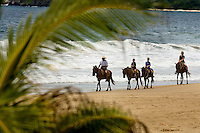 A family of American travelers enjoy riding horses on the beach in Zihuatanejo/Ixtapa. (Photos taken August 2007).  PHOTOS BY: PATRICK SCHNEIDER PHOTO.COM..Have model releases. Note: Also have Ixtapa high-adventure photos (not submitted)