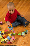 18 month old toddler boy stacking blocks making tower of 5 blocks