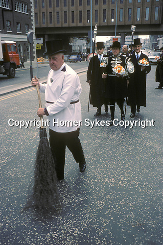 Vintners Company Procession, Upper Thames Street from Vintners Hall to St James Church Garlick Hill London. City of London. 1971 Sweeping the Road.
