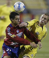 08 November 2006: CSD Municipal's Carlos Figueroa, left, and Columbus Crew's Rusty Pierce fight for position on a loose ball during the first half in Columbus, Ohio.<br />