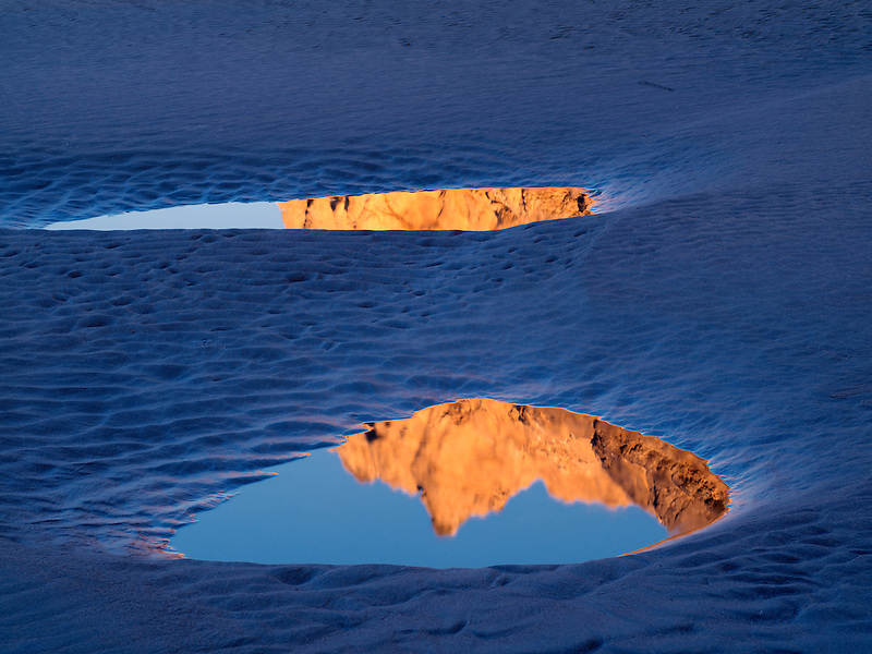 Sea stacks reflected in low tide pools. Bandon, Oregon