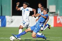 El Salvador defender Steve Purdy (4) goes against Honduras forward Carlos Costly (13) Honduras National Team defeated El Salvador 3-0 at RFK stadium, Saturday June 2, 2012.