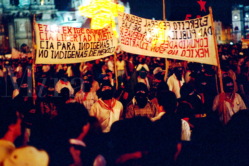 Demonstration in the Zocalo in support of EZLN (Ejercito Zapatista de Liberacion Nacional), the Zapatista agrarian reform movement. Masked Zapatistas and banners. Mexico City Mexico D.F. Mexico.