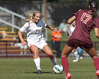 Boston College forward Rachel Davitt (24) passes the ball. Virginia Tech (maroon) defeated Boston College (white), 1-0, at Newton Soccer Field, on September 22, 2013.