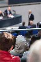 """30. Sitzung des Deutschen Bundestag am Freitag den 27. April 2018.<br /> Auf Antrag der rechtsnationalistischen """"Alternative fuer Deutschland"""", AfD, musste das Parlament ueber den Entwurf eines Gesetzes zur Aenderung Paragraph 130 des Strafgesetzbuchs (Volksverhetzung) diskutieren. Abgeordnete aller Fraktionen, ausser der Rechtsnationalisten, wiesen dies als Schritt zur Abschaffung des Paragraphen zurueck. <br /> Im Bild: Eine Zuschauerin mit Kopftuch auf der Besuchertribuehne.<br /> 27.4.2018, Berlin<br /> Copyright: Christian-Ditsch.de<br /> [Inhaltsveraendernde Manipulation des Fotos nur nach ausdruecklicher Genehmigung des Fotografen. Vereinbarungen ueber Abtretung von Persoenlichkeitsrechten/Model Release der abgebildeten Person/Personen liegen nicht vor. NO MODEL RELEASE! Nur fuer Redaktionelle Zwecke. Don't publish without copyright Christian-Ditsch.de, Veroeffentlichung nur mit Fotografennennung, sowie gegen Honorar, MwSt. und Beleg. Konto: I N G - D i B a, IBAN DE58500105175400192269, BIC INGDDEFFXXX, Kontakt: post@christian-ditsch.de<br /> Bei der Bearbeitung der Dateiinformationen darf die Urheberkennzeichnung in den EXIF- und  IPTC-Daten nicht entfernt werden, diese sind in digitalen Medien nach §95c UrhG rechtlich geschuetzt. Der Urhebervermerk wird gemaess §13 UrhG verlangt.]"""