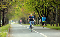 Pictured: A female cyclist pedals along the coastal path in Swansea, south Wales, UK. Friday 06 May 2016<br /> Re: Warm and sunny weather has been forecast for most of the UK.