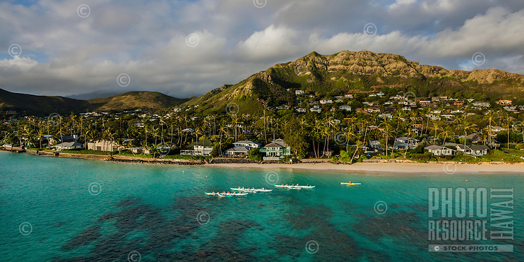 An aerial view of outrigger canoe paddlers in the waters off of the Lanikai neighborhood of Kailua, Windward O'ahu.
