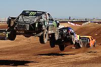 Apr 16, 2011; Surprise, AZ USA; LOORRS driver Rick Huseman (36) follows Ricky Johnson (48) and Adrian Cenni (11) during round 3 at Speedworld Off Road Park. Mandatory Credit: Mark J. Rebilas-.