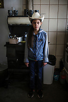 Portrait of the 10-year-old girl Cristina Burboa who wears a cowboy hat in her grandmother Domitila Burbua's kitchen on October 9, 2020 in the town of Fronteras, Mexico. Fronteras, Sonora. Cowgirl, face, look, jeans in sound.<br /> (Photo By Luis Gutierrez / Norte Photo)<br /> <br /> Retrato de la niña Cristina Burboa de 10 años que viste de sombrero vaquero en la cocina de su abuela Domitila Burbua el 9 octubre 2020 en el pueblo de Fronteras, Mexico.  Fronteras, Sonora. Vaquera, rostro, mirada, vaqueros en sonora.<br /> (Photo By Luis Gutierrez/Norte Photo)