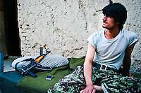 The Afghan National Army is composed of 200,000 active troops. This young soldier is posted on one of the hills inside the city of Kabul, defending it against insurgents who could use the place for their attacks on the governmental forces.
