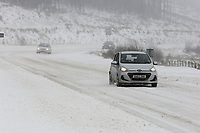 WEATHER PICTURE WALES<br /> Pictured: A car travels on the A470 road in Storey Arms, Brecon Beacons in south Wales, UK. Friday 02 March 2018<br /> Re: Beast from the East and Storm Emma has been affecting most parts of the UK.