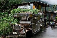 PHILIPPINEN, Ifugao Province, Cordilleras, abandoned Jeepney a well decorated minibus build from old US army jeeps / PHILIPPINEN, Ifugao Province, Cordilleras, schrottreifer Jeepney das lokale Transportmittel