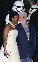 George Lucas and Mellody Hobson attend the STAR WARS: 'The Force Awakens' EUROPEAN PREMIERE at Odeon, Empire & Vue Cinemas, Leicester Square, England on 16 December 2015. Photo by David Horn / PRiME Media Images
