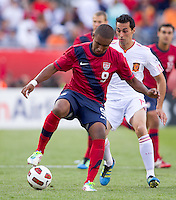 USA forward Juan Agudelo (9) controls the ball as Spain defender Alvaro Arbeloa (17) closes. In a friendly match, Spain defeated USA, 4-0, at Gillette Stadium on June 4, 2011.