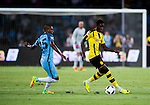 Manchester City midfielder Fernandinho Roza (l) fights for the ball with Borussia Dortmund striker Ousmane Dembele (r) during the match between Manchester City FC during their 2016 International Champions Cup China match at the Shenzhen Stadium on 28 July 2016 in Shenzhen, China. Photo by Marcio Machado / Power Sport Images