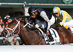 Joha and Rajiv Maragh win the 99th running of Dixiana Breeders' Futurity Grade 1 $400,000 at Keeneland Racecourse for owner Bluegrass Equine Bloodstock and trainer Michael Maker.  October 6, 2012.