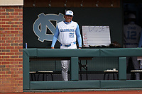CHAPEL HILL, NC - FEBRUARY 27: Head coach Scott Forbes of North Carolina stands in the dugout before a game between Virginia and North Carolina at Boshamer Stadium on February 27, 2021 in Chapel Hill, North Carolina.