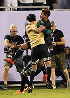 CHICAGO, IL - JULY 7: Jonathan Dos Santos #6 and his teammates celebrate his goal during a game between Mexico and USMNT at Soldier Field on July 7, 2019 in Chicago, Illinois.