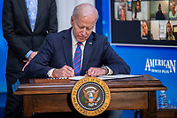 US President Joe Biden signs a proclamation during an event to mark Equal Pay Day in the State Dining Room of the White House in Washington, DC, USA, 24 March 2021. Equal Pay Day marks the extra time it takes an average woman in the United States to earn the same pay that their male counterparts made the previous calendar year.<br /> CAP/MPI/RS<br /> ©RS/MPI/Capital Pictures