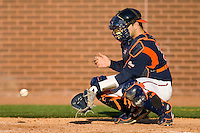 Catcher Franco Valdes #33 of the Virginia Cavaliers warms up the pitcher between innings at Clark-LeClair Stadium on February 19, 2010 in Greenville, North Carolina.   Photo by Brian Westerholt / Four Seam Images