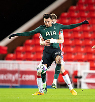 23rd December 2020; Bet365 Stadium, Stoke, Staffordshire, England; English Football League Cup Football, Carabao Cup, Stoke City versus Tottenham Hotspur; Dele Alli of Tottenham Hotspur is tackled with arms by Nathan Collins of Stoke City