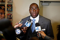 Los Angeles Dodgers co owner Magic Johnson during a press conference to introduce Zack Greinke as the newest member of the Los Angeles Dodgers at Dodger Stadium in Los Angeles, California on December 11, 2012. (Larry Goren/Four Seam Images)