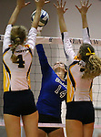 Marymount's Erin Allison hits in a college volleyball game against St. Mary's in Lexington Park, MD, on Wednesday, Oct. 29, 2014. Marymount won 3-2 to go 24-9 on the season.<br /> Photo by Cathleen Allison