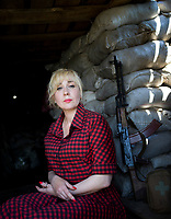 Natalia Voronkova (44), a volunteer who offers support and basic first aid training for Ukrainian government forces fighting Russian-backed separatists in the east of the country, at a military position near the frontline. As Natalia travels in the war zone she uses the opportunity to get a unfiltered sense of the reality and challenges the soldiers face on the ground; impressions she uses as a special advisor to the Ministry of Defence.