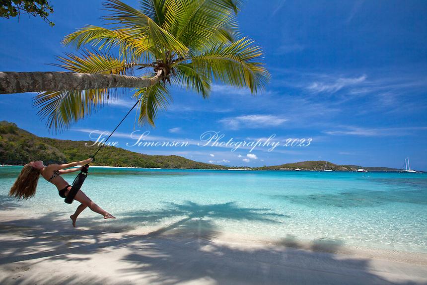 Young woman on a tire swing<br /> Oppenheimer Beach<br /> Virgin Islands National Park<br /> St. John<br /> U.S. Virgin Islands