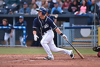 Asheville Tourists designated hitter Pat Valaika #16 swings at a pitch pitch during a game against the  Greenville Drive at McCormick Field on May 17, 2014 in Asheville, North Carolina. The Tourists defeated the Drive 14-6. (Tony Farlow/Four Seam Images)