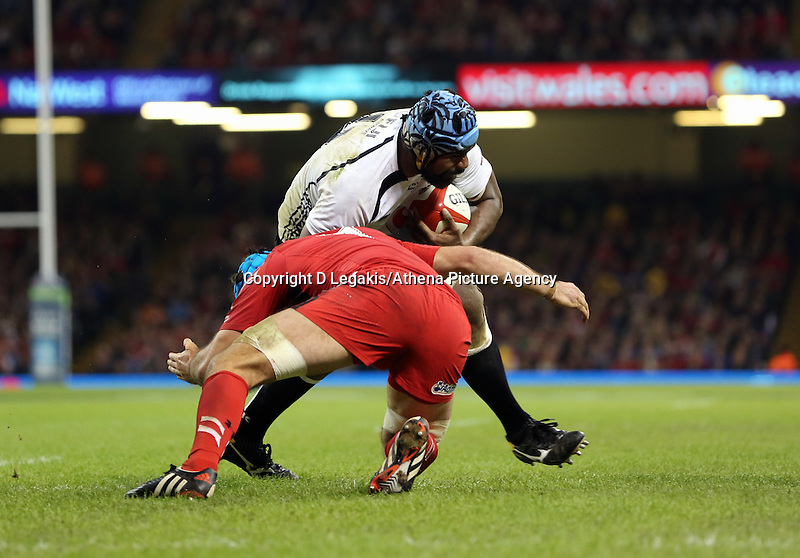 Pictured: Leone Nakarawa of Fiji is tackled by Justin Tipuric of Wales Saturday 15 November 2014<br /> Re: Dove Men Series rugby, Wales v Fiji at the Millennium Stadium, Cardiff, south Wales, UK.