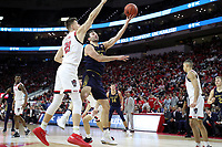 RALEIGH, NC - JANUARY 9: John Mooney #33 of the University of Notre Dame tries to shoot over Danny Dixon #21 of North Carolina State University during a game between Notre Dame and NC State at PNC Arena on January 9, 2020 in Raleigh, North Carolina.