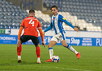 7th November 2020 The John Smiths Stadium, Huddersfield, Yorkshire, England; English Football League Championship Football, Huddersfield Town versus Luton Town; Ryan Tunnicliffe of Luton Town jockeys as Carel Eiting of Huddersfield Town attacks