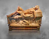 Etruscan funerary monument  known as  Adonis Dying, late 3rd century BC, made of terracotta and discovered near Tuscania, inv 14147, The Vatican Museums, Rome. Grey art Background. For use in non editorial advertising apply to the Vatican Museums for a license.