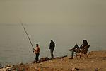 a palestinian fishermen fishing at gaza beach on january 11, 2018. Photo by Osama Baba