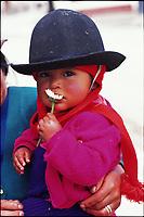 Quichua girl holding flower in the highlands. Ingapirca, Ecuador.