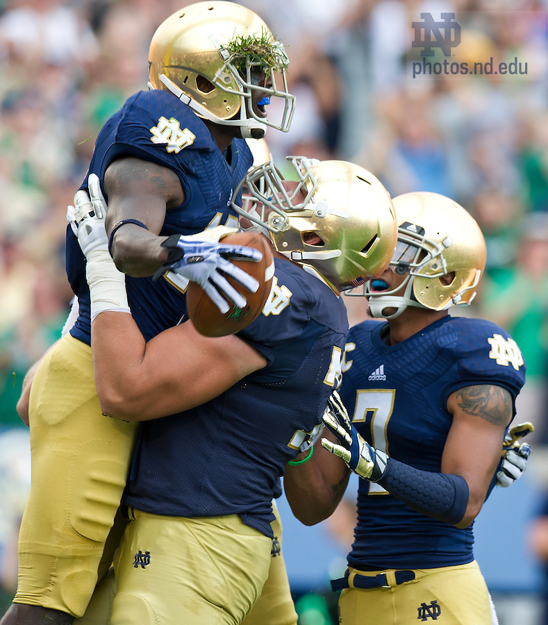 Aug. 31, 2013; Notre Dame wide receiver DaVaris Daniels celebrates his touchdown with teammates during the first quarter against Temple. Photo by Barbara Johnston/University of Notre Dame