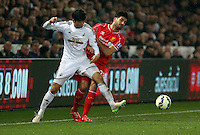 SWANSEA, WALES - MARCH 16: Emre Can of Liverpool (R) is challenged by Ki Sung Yueng of Swansea during the Premier League match between Swansea City and Liverpool at the Liberty Stadium on March 16, 2015 in Swansea, Wales