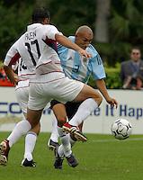 Chris Klein, left, Pablo Gui–azœ, right, Argentina vs. USA, Miami, Fla.