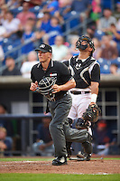 Umpire Brandin Sheeler gets in position in front of catcher Christian Correa (9) during a game between the Bowing Green Hot Rods and Quad Cities River Bandits on July 24, 2016 at Modern Woodmen Park in Davenport, Iowa.  Quad Cities defeated Bowling Green 6-5.  (Mike Janes/Four Seam Images)
