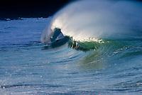 Beautiful wave cresting at the shore break of Waimea Bay on the North Shore of Oahu, Hawaii.