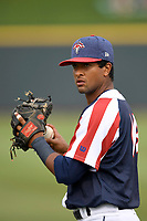 Second baseman Luis Carpio (18) of the Columbia Fireflies warms up before a game against the Rome Braves on Monday, July 3, 2017, at Spirit Communications Park in Columbia, South Carolina. Columbia won, 3-2. (Tom Priddy/Four Seam Images)