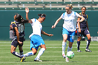 Kelly Smith #10 of the Boston Breakers controls the ball while  Kristine Lilly #16 and Marta #10 of the Los Angeles Sol battle during their WPS match at Home Depot Center on May 10, 2009 in Carson, California.