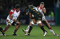 Friday 7th December 2012;  Nick Williams and Roger Wilson combine to tackle Courtney Lawes during the Pool 4 round 3 Heineken Cup clash at Franklin's Gardens, Northampton, England. Image credit -: JOHN DICKSON / DICKSONDIGITAL