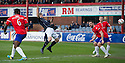The ball deflects off Dundee's Jim McAlister and goes in for their third goal.