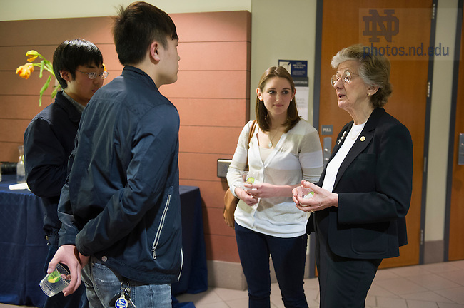 """Mar. 19, 2014; Rita Colwell, former director of the National Science Foundation; chair of Canon US Life Sciences, Inc.; professor at the University of Maryland at College Park and Johns Hopkins University Bloomberg School of Public Health, talks with students at the reception following her lecture titled, """"Oceans, Climate, and Human Health: The Cholera Paradigm,"""" in DeBartolo Hall. Colwell's talk is part of the 2013-14 Notre Dame Forum: Women in Leadership. <br /> <br /> Photo by Barbara Johnston/University of Notre Dame"""