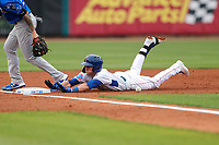 Tennessee Smokies shortstop Andy Weber (7) slides into third base against the Biloxi Shuckers on May 18, 2021, at Smokies Stadium in Kodak, Tennessee. (Danny Parker/Four Seam Images)