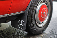 The front wheel mud flap of the Mercedes W123 series 230TE estate version, outside the Penderyn Whisky Distillery in south Wales, UK. Tuesday 19 June 2018