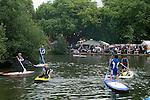 Barnes southwest London Uk. Barnes village pond annual summer, Barnes Fair. Children paddling on village pond with adult supervision.